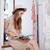 mooie · jonge · vrouw · dienst · kassa · store · ondiep - stockfoto © deandrobot