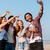 group of cheerful friends taking selfie with mobile phone outdoors stock photo © deandrobot