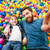 boy and his father playing at pool with colorful balls stock photo © deandrobot