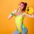 fiatal · nő · izolált · citromsárga · mutat · remek · kézmozdulat - stock fotó © deandrobot