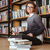 улыбаясь · женщины · студент · используя · ноутбук · библиотека · портрет - Сток-фото © deandrobot