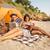 カップル · 座って · ビーチ · 笑みを浮かべて · 男 · 冬 - ストックフォト © deandrobot