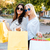 stylish young ladies in sunglasses walking down the street stock photo © deandrobot