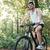 gülen · bisikletçi · orman · yandan · görünüş · adam · spor - stok fotoğraf © deandrobot