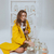 lovely woman in raincoat sitting near jars with gold fishes stock photo © deandrobot