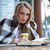 портрет · счастливая · девушка · сидят · книга · кафе · глядя - Сток-фото © deandrobot