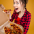 Joyful charming young woman standing and tasting pizza stock photo © deandrobot