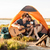 portrait of a man playing guitar for his girlfriend camping stock photo © deandrobot