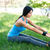 sporty woman doing stretching exercsises in park stock photo © deandrobot