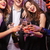 group of cheerful young friends drinking champagne together stock photo © deandrobot