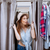 Surprised young woman looking out of dressing room stock photo © deandrobot