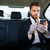 handsome bearded business man in suit using mobile phone stock photo © deandrobot