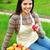 portrait of smiling woman with basket apples against green grass stock photo © deandrobot