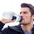 geschikt · man · drinkwater · geïsoleerd · witte · handdoek - stockfoto © deandrobot