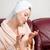 kobieta · mówić · telefonu · sofa · salon - zdjęcia stock © deandrobot