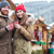 happy couple drinking coffee on christmas market in mountain resort stock photo © deandrobot