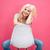 glimlachend · aantrekkelijke · vrouw · vergadering · stoel · roze · naar - stockfoto © deandrobot