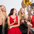 cheerful women drinking champagne talking and laughing on the party stock photo © deandrobot
