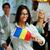 feliz · mujer · de · negocios · bandera · Rumania · colegas - foto stock © deandrobot
