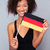 afro american woman holding germany flag stock photo © deandrobot