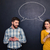 couple using smartphones over blackboard with speech dialogue stock photo © deandrobot