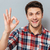 portrait of a happy man showing okay gesture stock photo © deandrobot