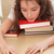 tired schoolgirl with her chin on books stock photo © deandrobot