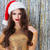 portrait of attractive young woman in santa claus hat stock photo © deandrobot