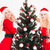 two smiling sisters twins in santa claus dresses and hats stock photo © deandrobot