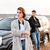young couple standing at their car on the seaside stock photo © deandrobot