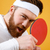 Attractive young sportsman holding racket for table tennis. stock photo © deandrobot