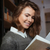 close up of a student girl reading book in library stock photo © deandrobot