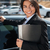 cheerful businesswoman with folder near black car stock photo © deandrobot