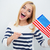 cheerful young girl holding usa flag stock photo © deandrobot