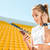 woman using smartphone on stadium stock photo © deandrobot