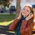 donna · ascoltare · musica · parco · indossare · cuffie · sorridere - foto d'archivio © deandrobot