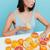 mooie · vrouw · vergadering · tabel · sinaasappelen · mooie · jonge · vrouw - stockfoto © deandrobot
