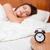 nő · alszik · ágy · fókusz · ébresztőóra · léggömb - stock fotó © deandrobot