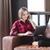 mulher · jovem · usando · laptop · celular · sessão · piso · negócio - foto stock © deandrobot