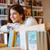 jóvenes · femenino · estudiante · libros · biblioteca - foto stock © deandrobot