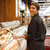 happy lady standing in supermarket choosing pastries stock photo © deandrobot
