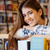 sonriendo · jóvenes · femenino · estudiante · biblioteca · retrato - foto stock © deandrobot