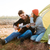 uomo · giocare · chitarra · fidanzata · seduta · tenda - foto d'archivio © deandrobot