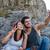 smiling couple make selfie on rock stock photo © deandrobot