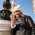 aantrekkelijk · jonge · vrouw · hoed · lopen · straat - stockfoto © deandrobot