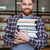 portrait of a smiling man student holding books in library stock photo © deandrobot