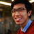 closeup portrait of a young smiling asian man with glasses stock photo © deandrobot