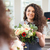 cheerful woman florist holding flower bouquet and looking at mirror stock photo © deandrobot