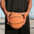 portrait of male hands holding basketball with playground on background stock photo © deandrobot