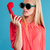 beautiful stylish blonde in sunglasses holding red telephone tube stock photo © deandrobot